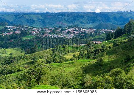 Beautiful lush green landscape with the town of Salento Colombia visible in the background