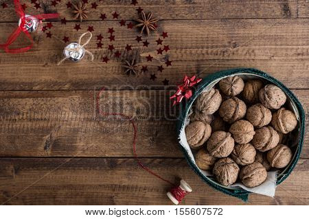 Christmas Scene of Walnuts and Festive Decorations on Rustic Table