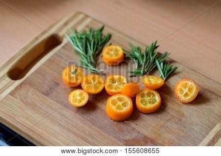 Sliced kumquat, and Basil. The beautiful wooden butcher