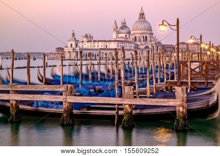 Cityscape View Of Santa Maria Della Salute And Gondolas