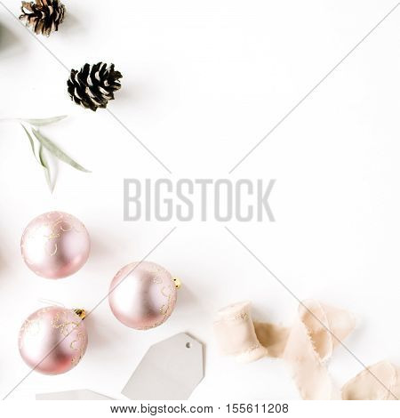 Christmas composition. Fir branches pine cones christmas balls ribbon and tinsel. Flat lay top view