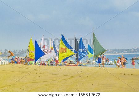 PORTO GALINHAS, BRAZIL, JANUARY - 2016 - Lots of sailing boats at tropical beach in Porto Galinhas Pernambuco Brazil