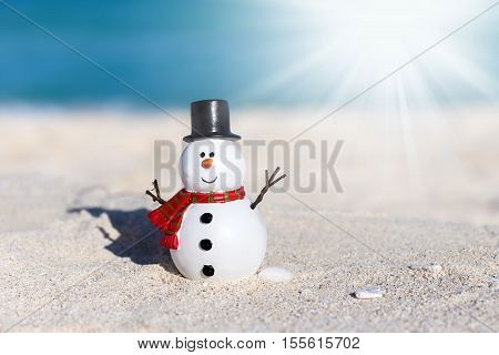 Snowman Toy On White Sandy Beach