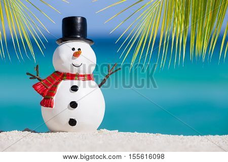 Snowman Toy At White Sandy Beach