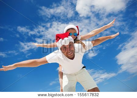 Happy Smiling Couple Piggyback Together, Celebrating Christmas
