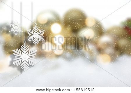 Hanging Christmas snowflake decorations on a defocussed background