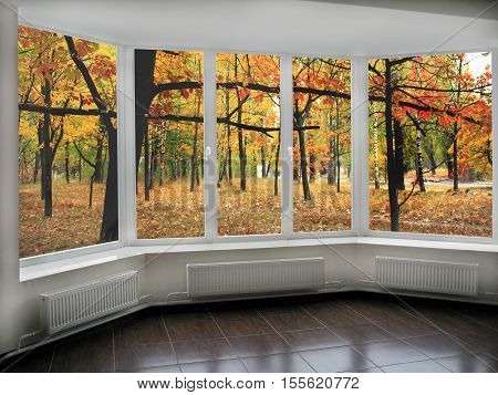 big panoramic windows with view to oaken autumnale forest