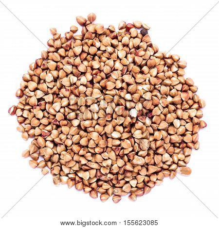 Buckwheat piles / premium buckwheat groats on white background
