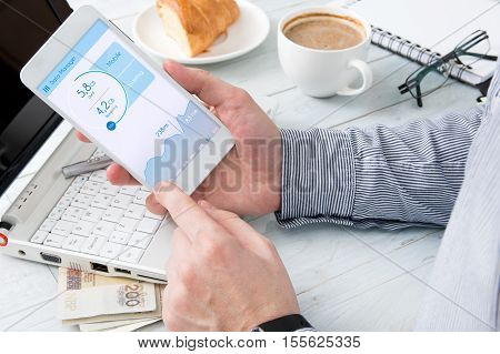 Man is checking data usage on his smartphone