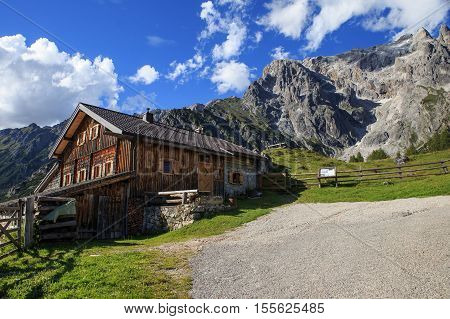 Typical mountain huts in the Austrian Alpson a sunny day with rocky mountains in the background