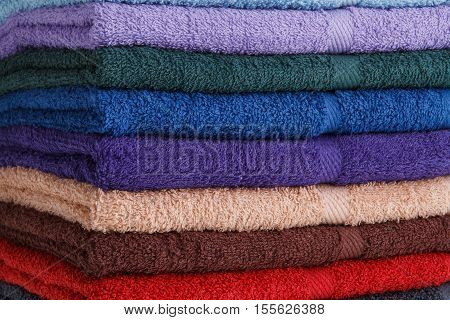 Stack of colorful towels. Towels for personal hygiene.