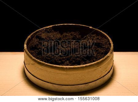The swedish tobacco product snus in a box with a dark background.