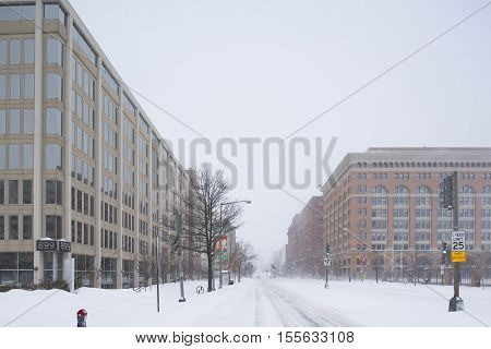 Washington D.C. USA - January 23 2016: Snow-covered empty road during a snowstorm.