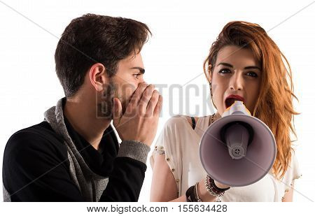 Man talking the ear of another girl with megaphone