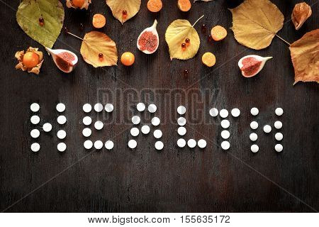 concept health - treatment with hot tea and medecine on wooden background top view