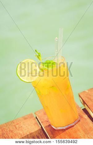 Mango Mojito On The Wooden Pier. Concept Of Luxury Tropical Vacation. Classic Cocktail