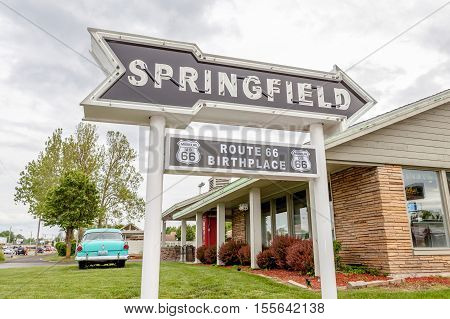 Springfield Missouri USA- May 18 2014. Springfield road arrow sign with cafe background in best western route 66 rail haven.