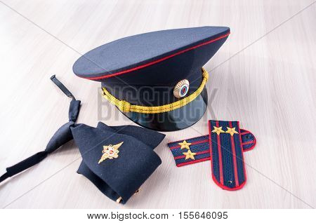 Still Life: cap tie and epaulettes police