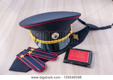 On the table lay a cap tie straps police lieutenant colonel and a pension certificate AMIA Russia
