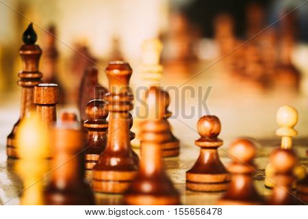 Chess wooden figures in a blur. Installing the game of chess