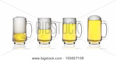 front view frosty lager light beer and white bubbles four level set in clear glass with handle and steam for winter drink or celebration isolated on white background and reflection for beer glass