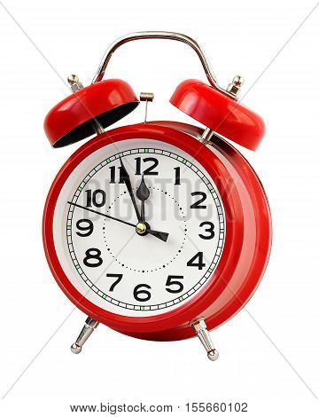 Red retro alarm clock at twelve o'clock isolated on white background. Midnight midday. Minutes about New year.