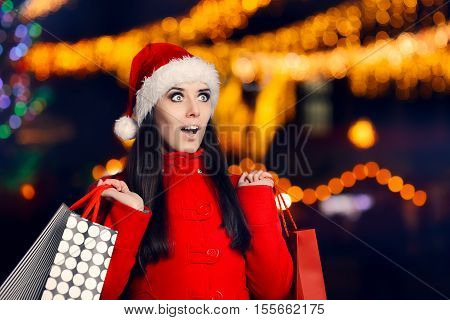 Amazed Woman With Shopping Bags in Christmas Fair