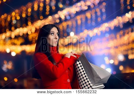 Curious Woman With Shopping Bags in Christmas Market