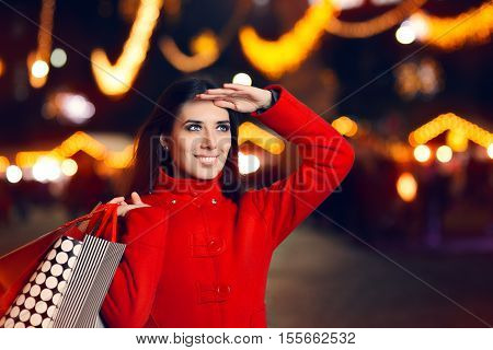 Smiling Woman With Shopping Bags in Christmas Market
