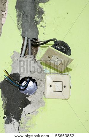 Electrical installation in an old building wall
