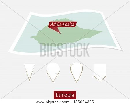 Curved Paper Map Of Ethiopia With Capital Addis Ababa On Gray Background. Four Different Map Pin Set