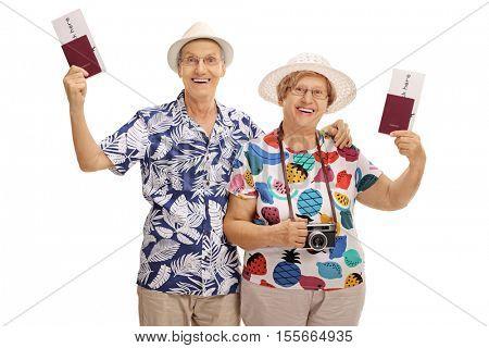 Joyful mature tourists holding passports isolated on white background
