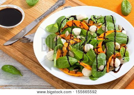 Chargrilled Pumpkin, Mini Mozzarella And Spinach Salad Seasoned With Seeds