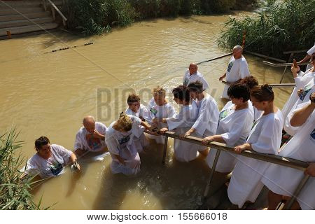 Jericho, Israel - November 1, 2016: Group of Pilgrims at the Baptism Site called Qasr el Yahud. Ist located at Jordan River in the Region oft he West Bank in Israel