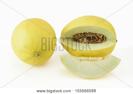Sliced and whole yellow honeydew melon on a white background
