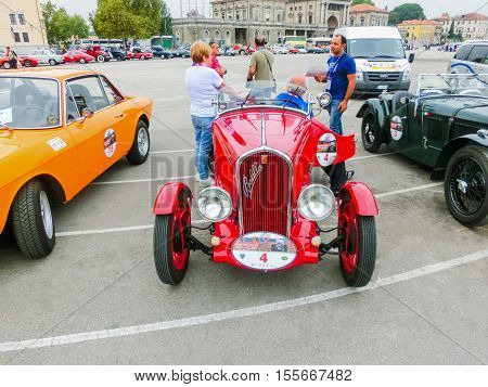 Padua, Italy - September 19, 2014: Benefit Antique Classic Car Show: People are the members and sitting at the car at Benefit Antique Classic Car Show at Padua at September 19, 2014. Cars and enthusiasts from all over Italy.