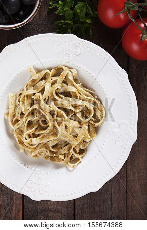 Italian fettucine pasta with basil pesto genovese