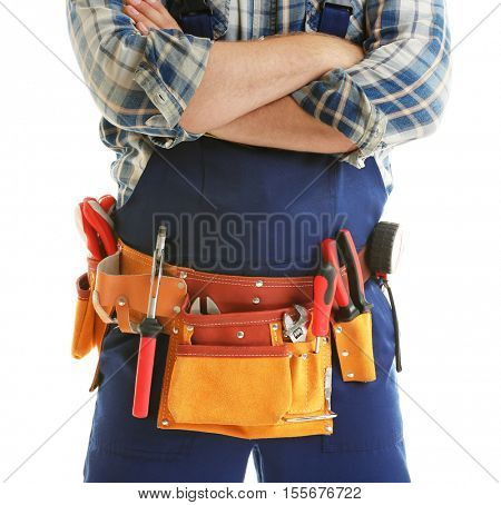 Worker with tools belt isolated on white, close up view