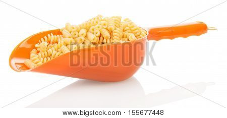 Scoop with helical pasta isolated on white background.