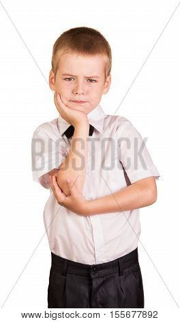Befuddled cute schoolboy isolated on white background.