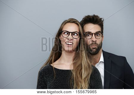 Couple pulling goofy funny faces for camera
