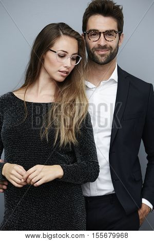 Beautiful couple wearing fashionable eye glasses portrait