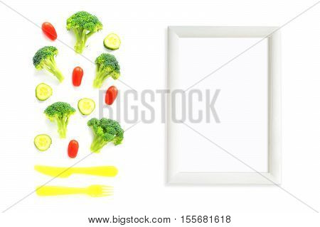 Broccoli, Tomatoes And Cucumbers Composition With Cutlery And Frame