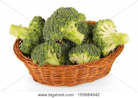 Fresh broccoli in a basket isolated on white background.
