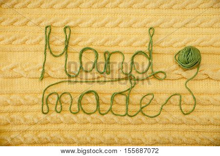 Yellow Knitted Background with Pattern and Braids; Green Ball.Hand Made;Fancywork.Sign Hand-made from Thread poster