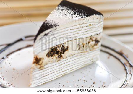 tiramisu crepe cake dish on the table,tiramisu