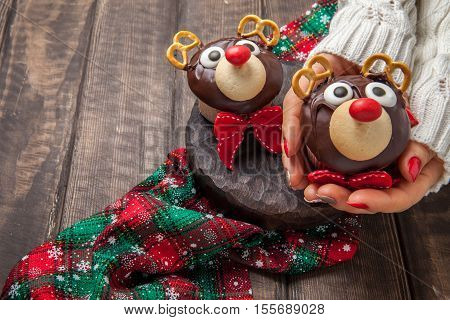 Funny Christmas reindeer cupcake. Delicious gift for xmas or new year