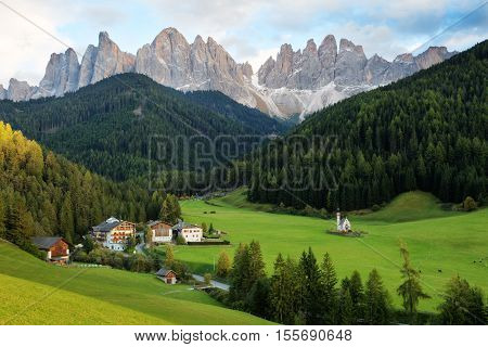 Santa Maddalena village in front of the Geisler or Odle Dolomites Group Val di Funes Italy Europe.