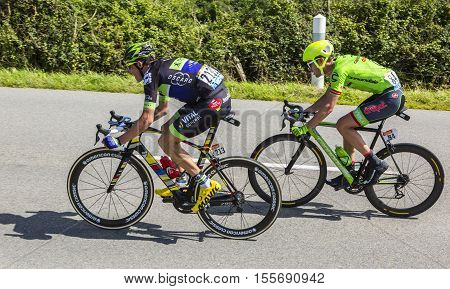 QuinevilleFrance- July 2 2016: The cyclists Anthony Delaplace of Fortuneo-Vital Concept Team and Alex Howes of Cannondale-Drapac Team riding in the breakaway during the first stage of Tour de France in Quineville France on July 2 2016.