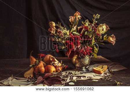 Still life with apples and autumn flowers